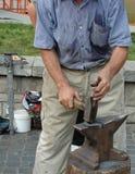 Smith at Work. Smith making horseshoe stock images