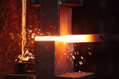 Smith work with hammet and steel stick. Smith work  with hammet and steel stick on the anvil Stock Image