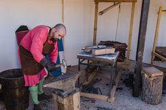 Smith working in a medieval forge Stock Photo