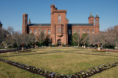 Smithsonian Castle and Garden. Smithsonian Castle (headquarters for Smithsonian Institution) and formal gardens, Washington, DC Royalty Free Stock Photography