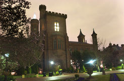 Smithsonian Castle Garden Night Washington DC. Smithsonian Castle and Garden Institution Night with Magnolias Washington DC Royalty Free Stock Photos