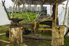 Smithy. Messy medieval smithy with steel anvil Stock Image