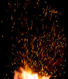 Smithy fire flame tips with sparks closeup Royalty Free Stock Photo
