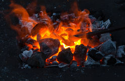 Smithy fire flame tips with sparks closeup Royalty Free Stock Images