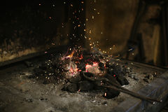 Smithy fire flame tips with sparks closeup on dark background Stock Image