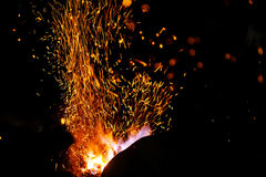 Smithy fire flame tips with sparks  on dark background Royalty Free Stock Images