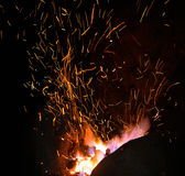 Smithy fire flame tips with sparks  on dark background Royalty Free Stock Photo