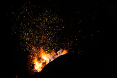 Smithy fire flame tips with sparks  on dark background Stock Images