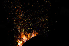 Smithy fire flame tips with sparks  on dark background Royalty Free Stock Image