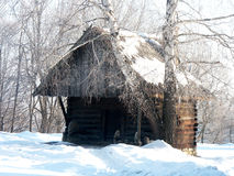 Smithy. Old antique wooden forge a Winter Coat Stock Photo