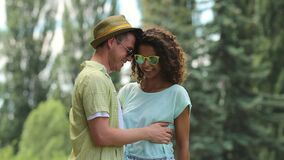 Smitten couple smiling and hugging gently, giving each other an Eskimo kiss. Stock footage stock footage