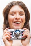 Smlig young woman with photo camera Royalty Free Stock Images