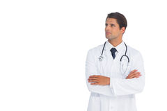 Smliing doctor with arms crossed looking up Royalty Free Stock Photos