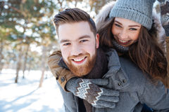 Smling couple walking in winter park Royalty Free Stock Photography