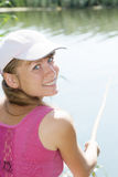 Smling fisherwoman Stock Images