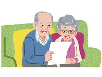 Smling Senior couple looking at documents Royalty Free Stock Image