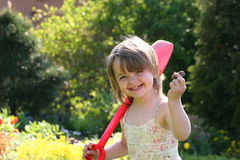 Smll Girl with the shovel. I got a stone - this is my treasure royalty free stock photography