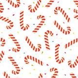 Sömlös julmodell för vektor med sötsaken, klubban och konfettier Royaltyfria Foton