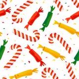 Sömlös julmodell för vektor med sötsaken, klubban och konfettier Royaltyfri Fotografi