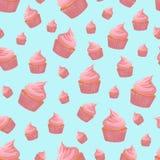 Sömlös modell med den rosa muffin på blå bakgrund Royaltyfria Bilder