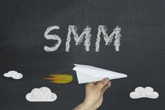 SMM concept on black chalkboard royalty free stock photos