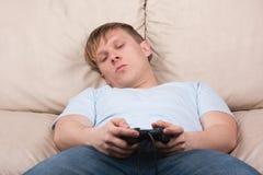 sömnig gamer Fotografering för Bildbyråer