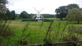 Smock windmill. White sails countryside stock images