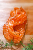 Smocked salmon slices and dill Royalty Free Stock Image