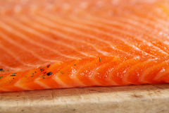 Smocked spiced salmon homemade on wooden board Royalty Free Stock Photography