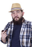 smocking管子的英俊的行家 免版税库存照片