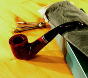 Smocking pipe set 1. A set of equipment necessary to smoke pipe. It consist from pipe, bag for the tobacco, tools for maintaining the pipe  an box in everything Royalty Free Stock Photography