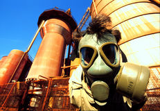 Smog 2. Man with antigas mask with industries background Royalty Free Stock Photography
