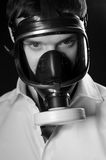 Smog. Man with gas mask, looking to camera Stock Images