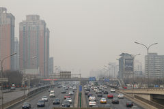Smog in Beijing. A busy road in Beijing China with visible smog in the air Stock Image
