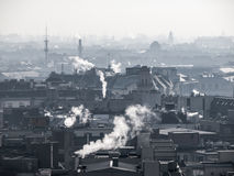 Smog - city air pollution. Unclear atmosphere polluted by smoke rising from the chimneys. Smog - city air pollution. Unclear foggy atmosphere polluted by smoke Stock Images