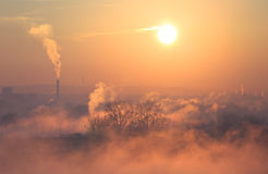 Smog. Fog and pollution in Lyon during a winter sunrise Royalty Free Stock Photo