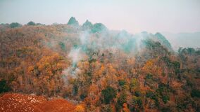 Smog of bushfire fires. Deforestation and Climate crisis. Toxic haze from rainforest fires. Aerial video 4k.