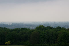 Smog over the city. Brussels covered in a cloud of smog Royalty Free Stock Photo