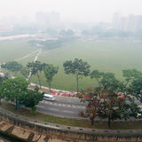 Smog over housing estate in Singapore. Bird's eye view of the effect of smog covering Singapore caused by forest clearing for plantation use using slash and burn stock images