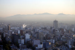 Smog over Mexico City. Skyline of downtown Mexico City at sunrise, with dense smog obstructing the view Royalty Free Stock Photography