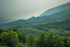 Smog over small mountains of the Alps. Italy royalty free stock photography