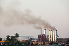Smog pollution sugar mill Stock Image