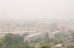 Smog in the town. Smog in a Siberian town in Russia Stock Photos