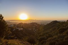Smoggy Sunrise View of Hollywood and Downtown Los Angeles stock images