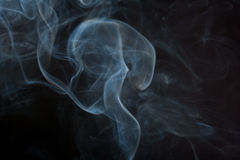 Smoke. Abstract blue smoke isolated on black background Stock Photography
