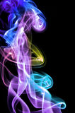 Smoke. Colored smoke isolated  on a black background Stock Photos