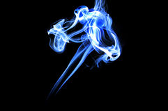 Smoke. Colored smoke isolated  on a black background Royalty Free Stock Image