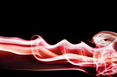 Smoke. Colored smoke isolated  on a black background Stock Images