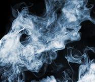 Smoke. Mystic blue smoke close-up. Black background Royalty Free Stock Photos