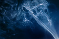 Smoke. Blue smoke on a dark background Royalty Free Stock Photography